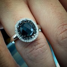 A single rose cut black diamond totaling 2.20 carats carat sits surrounded by a halo of 60 sparkling white and black diamonds totaling 0.37cts . This Coby Madison unique 14k white gold black diamond ring the perfect ring for your sweetheart.