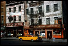 Whitehall St from Peter Minuit near Battery Park. photo by Cushman, 1960