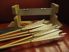 Arrow Fletching Jig - Homemade arrow fletching jig constructed from MDF, aluminum, and bulldog spring clips.