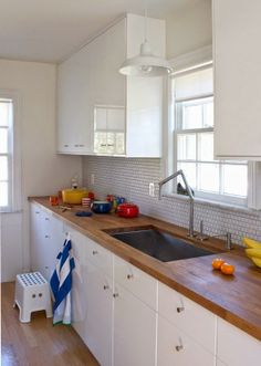white modern cabinetry, butcher block counter, modern faucet #LGLimitlessDesign #contest