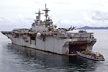 Wasp class USS Essex (LHD-2) near Thailand, conducting  a stern gate mating with Landing Craft Utility 1631 into the well deck.