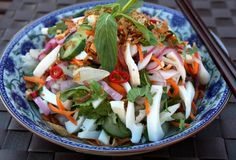 Squid Salad Gỏi Mực – Vietnamese Squid Salad Serves 2 1 large squid tube (250g) 1/2 carrot, 1 cucumber, 1 red onion,  1/3 cup pickled spring onions,  1/4 cup coriander, 1/4 cup mint (preferably Vietnamese mint),  1 red chilli,  fried shallots (for garnishing) roughly crushed peanuts (for garnishing) Fish sauce dressing 3 tablespoons fish sauce 1 tablespoons white vinegar 2 tablespoons sugar 1/2 cup boiling water 2 garlic cloves chopped 1 chilli, chopped 2 tablespoons lemon juice