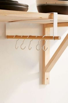 This under-shelf storage rack ($26).   34 Wonderful Products For People Who Hate Clutter