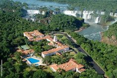 "Aerial view of ""Hotel das Cataratas"" (Hotel of Falls), Brazil - in upperside, a big part of Iguazu Falls, Argentine side"