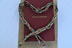 Handfasting Wedding Ritual, Celtic wedding custom with a coloured binding ribbon Marriage Celebrant, Wedding Rituals, Hands Together, Celtic Wedding, Handfasting, Wedding Ceremony, Beaded Necklace, Ribbon, Bride