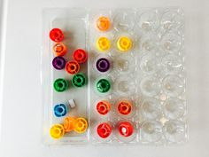Looking for a matching color pair for each lid, 40+ activities for toddlers, activities for 18-24 month old, activities for 18 month old, activities for 19 month old, activities for 20 month old, activities for 21 month old, activities for 22 month old, activities for 23 month old, activities for 24 month old, activities for two year old, activities for three year old, learning activities for toddlers