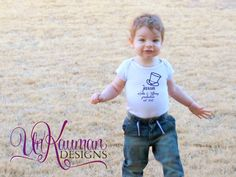 Baby Onesie  A production with parents name and by UnKaumanDesigns