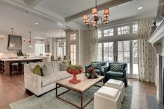 I like the idea of 1 sofa, 2 chairs, and 2 square ottomans. modern living room furniture placement and living room designs