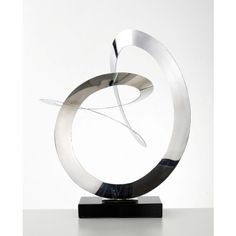 Circumfusion - Impressive Abstract Sculpture, Polished Stainless Steel on marble by Nova Deko.