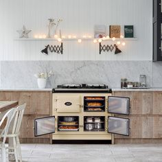 How does an AGA range cooker work? An AGA is always ready to cook instantly, there are no switches & dials - Find out how an AGA heat storage oven works today
