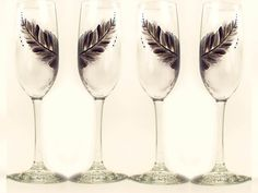 Hey, I found this really awesome Etsy listing at https://www.etsy.com/listing/193076419/hand-painted-champagne-glasses-feather