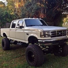 white OBS crew cab Ford pickup truck