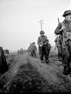 Infantrymen of The Royal Winnipeg Rifles advancing through fields during Operation SPRING near Ifs, France, 25 July 1944. (item 1)