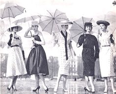 Umbrellas with vintage hats and dresses. 1950s