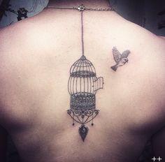Birdcage on back by Octavio Camino