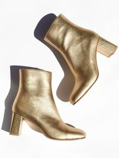 Split toe boot by Maryam Nassir Zadeh. Block heel. Slight square toe. Interior zip. Fits true to size. Made in Turkey. Heel Height: 7cm Color: Gold Metallic Sizing: American