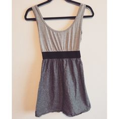 Grey tank dress Grey soft cotton on top and feathered grey bottom. Really cute on, has a baby doll feel. Dresses Mini