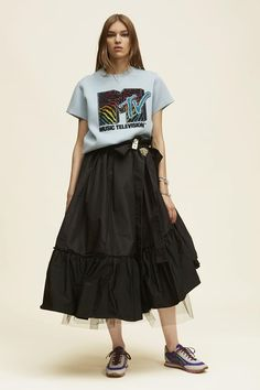 Marc Jacobs picked the perfect timing for its MTV-inspired pieces to hit pre-sale—right in the aftermath of the 2016 VMAs. The looks—consisting of neon sweaters emblazoned with the network's retro logo to subtler iterations like graphic tees with a small label on the chest—are now available for pre-order online.    Here, a short sleeve embroidered MTV sweatshirt.