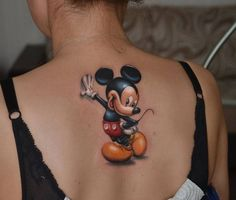 Realistic Mickey Mouse tattoo on the girl's upper back