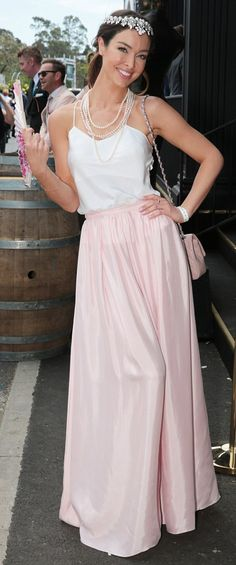 Fit for a princess: The Bachelor Australia contestant Laurina Fleur wore a royal-esque headpiece and plenty of pearls with her delicate white camisole and pink maxi skirt, a hand-held fan giving her outfit a regal look