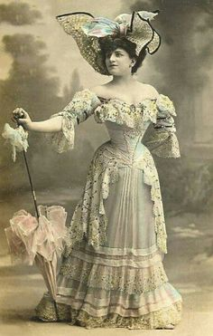 Lovely 1900's fashion This lady looks so skinny( how does she do it) :)