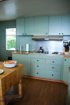 wonderful color and wood for kitchen. also, I want a giant wood movable island.