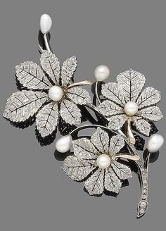 A late 19th century pearl and diamond spray brooch, by Mellerio dits Meller. Of foliate design, the detachable leaves set with rose-cut diamonds and highlighted with 5.0mm-6.5mm baroque pearls, mounted in silver and gold, maker's mark MM, French assay mark.