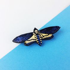 This listing is for one bright blue moth pin, made from wood and finished up on a silver or gold plated pin.  This little beauty measures about 4 x 3cm.  An ideal little treat for yourself or a friend to brighten up bags, cardigans and jackets.   To see more brooches, click here: https://www.etsy.com/uk/shop/AubergineFox/items?ref=pagination&search_query=brooch ☆ CARE INFORMATION ☆  Our lasercut wood brooches are very resilient and wear well on jack...