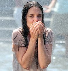 While filming a scene for a new movie, Katie Holmes got to spend her day frolicking around in a fountain, creating an impromptu one-woman wet T-shirt contest.