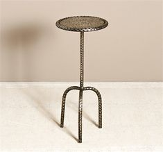 With a hammered texture and an antique silver finish, the classic shape of a three-legged round iron table gets an artisanal twist. x Featured: Material: Iron Finish: Antique Silver Side Table, Burke Decor, Pub Table, Rustic Lighting, Recycled Home Decor, Drink Table, Organic Furniture, Iron Table, Rustic Mirrors
