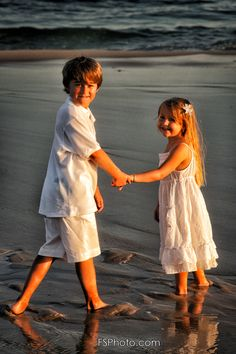 Photography - Portrait of brother and sister playing on the beach