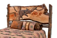 Carved Log Bed with Lazy Bear by Woodland Creek. Custom carved beds made with the scene of your choice.