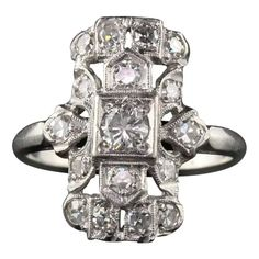 For Sale on 1stDibs - Beautiful Art Deco platinum diamond shield ring in good condition. #R0419 Metal: Platinum Weight: 3.4 Grams Total Diamond Weight: Approximately 0.75 CTS