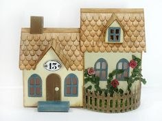 Cute little cottage made by combining the Tim Holtz Village Dwelling and Village Brownstone Christmas Village Houses, Putz Houses, Christmas Villages, Christmas Home, Christmas Crafts, Halloween Village, Doll Houses, Tiny Houses, Tim Holtz