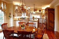 A Creamy White Kitchen with Antique Kitchen Cabinets  (Kitchen-Design-Ideas.org)