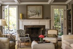 A producer and her composer husband stage the restoration of an historic 1740s homestead. The new family room was designed to connect with the outdoors. French doors lead to a stone patio.