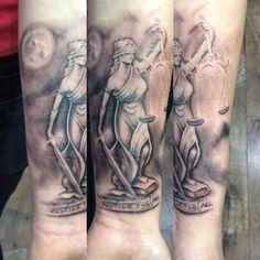 Themis tattoo
