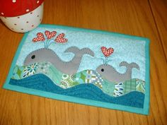 Whales Mug Rug pattern $1.99 on Craftsy at http://www.craftsy.com/pattern/quilting/home-decor/whales-mug-rug/57799