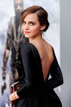 I love EMMA'S bare back in this photo. Emma is so Sexy. SHE ABSOLUTELY BRINGS NEW MEANING TO THE WORD SEXY.