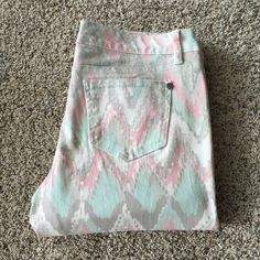 """NWT tribal print skinny jeans Super cool tribal print in pastel shades of pink/mint green/grey cover these skinny jeans by Hot Kiss. Intentional whiskering on front adds visual interest. Zip and 1 button closure. Pockets front & back. Brand style: Skinny Lily. 98% cotton, 2% spandex. Tagged sz. 10 but would fit sz. 8/10 best IMO. Measures 17"""" at waist with 31"""" inseam and 9"""" rise. Perfect condition! NWT. Hot Kiss Jeans Skinny"""