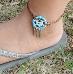 Turquoise Dream Catcher Leather Anklet Adjustable Bracelet and Feathers. $24.00, via Etsy.
