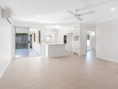 Dulux Lexicon Quarter features in this open plan kitchen and living zone by Your Asset Renovations
