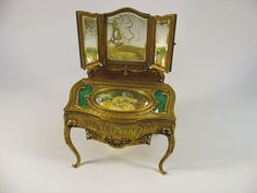 French bronze & enamel miniature dressing table dresser box from the late 19th or early 20th Century. Made of gilded bronze with inset enamel panels, there is a signed portrait on ivory set into the top.