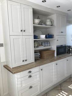 My finished kitchen makeover. Cast in style - cup handles and wenlock cabinet pulls. Existing Ikea cabinets painted in Farrow and Ball Skimming Stone.