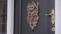 Surprisingly haunting door knocker