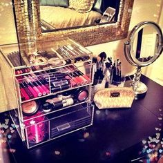 Really liking the clear glass jewelry/makeup storage idea