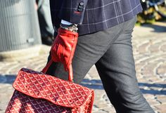making a statement, red gloves and Goyard, nothing less.