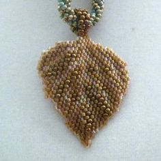 Bronze Leaf Necklace on Beaded Rope Source: Copyright Brenda (vidrotecido)