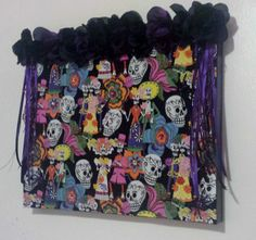 Dia De Los Muertos - Perfect for any girl who loves color and has a sense of humor. Day of the Dead wedding adorned with purple and black silk flowers. Black Silk, Purple And Black, Plastic Beads, Silk Flowers, Glass Beads, Wax, African, Humor, Wall Art
