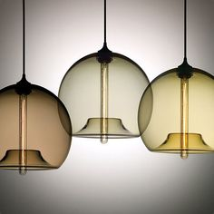 Stamen Lamp, from Niche Modern, comprises a hand-blown glass shade wrapped around  a tubular dimmable incandescent bulb.
